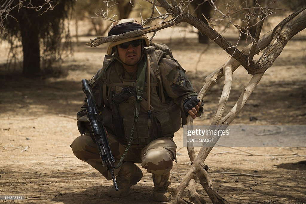 A French soldier of the 92nd Infantery Regiment takes part on April 10, 2013, 105 kms north of the northeastern Malian city of Gao, in day three of Operation Gustav, a hunt for Islamist fighters in a valley in northern Mali and one of France's largest military operations during its three-month intervention in its former colony. Operation Gustav comes with France preparing to withdraw three-quarters of the 4,000 troops it deployed in January to block a feared advance on the Malian capital Bamako by Al Qaeda-linked insurgents.
