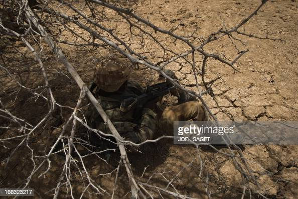 A French soldier of the 92nd Infantery Regiment takes part on April 10 105 kms north of the northeastern Malian city of Gao in day three of Operation...
