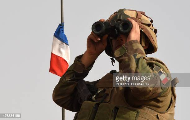A French soldier of the 93rd Mountain Artillery Regiment part of the French Army's 'Operation Barkhane' an antiterrorist operation in the Sahel looks...
