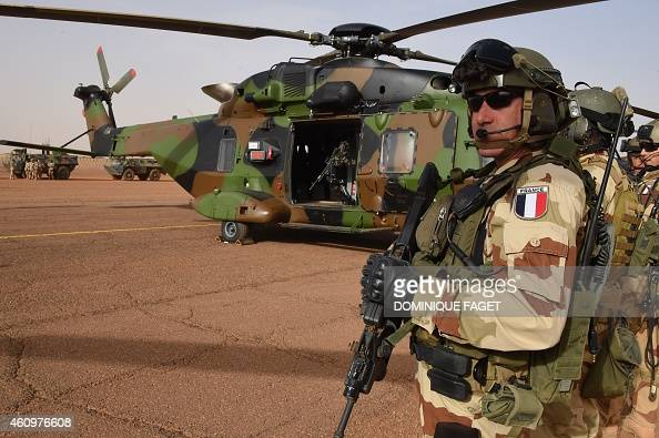 A French soldier of the detachment of the Operation Barkhane stands guard on January 2 2015 at a French base outside the northern Malian city of Gao...