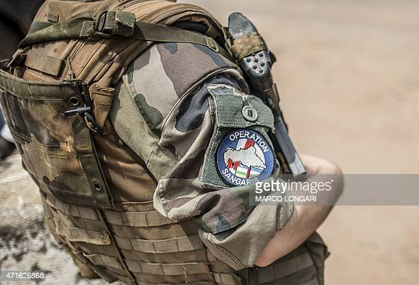 A French soldier of the Sangaris contingent mans is seen at a checkpoint in the formerly Muslim PK12 district of Bangui on June 4 2014 French...
