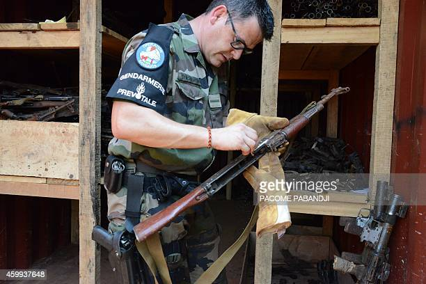 A French soldier of the Sangaris operation takes weapons apart on december 4 2014 in Bangui The French military operation called 'Sangaris' was...