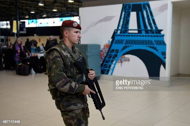 A French soldier patrols at the Charles de Gaulle Airport in Roissy northeast of Paris on November 14 following a series of coordinated attacks in...