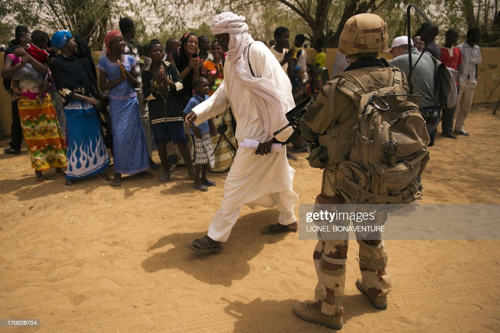 A French soldier patrols in the street in Gao on June 13 2013 Gao fell in March last year to Tuareg rebels who declared the independence of the...