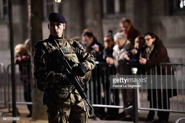 French Soldier patrols outside Notre Dame Cathedral ahead of a ceremony to the victims of the friday's terrorist attacks on November 15 2015 in Paris...
