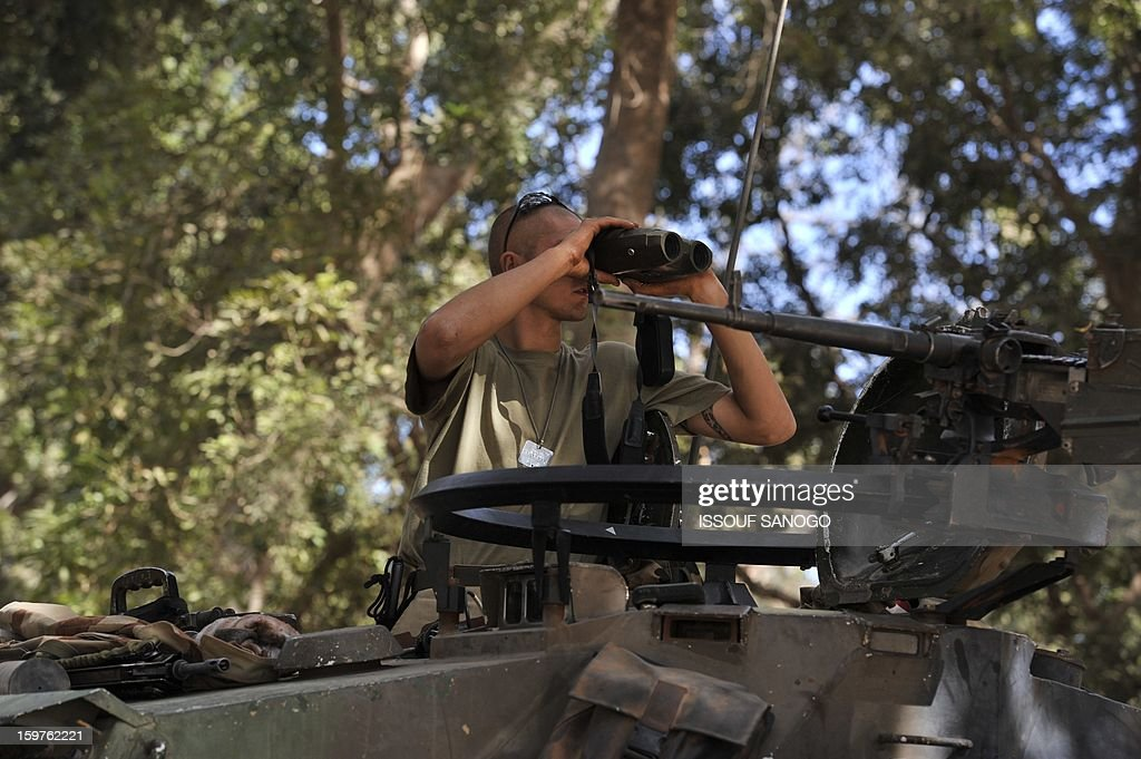 A French soldier sits on a tank on January 20, 2013 in the city of Niono, about 350 kms (220 miles) northeast of the capital Bamako and 60 kms south of Diabaly, which was seized on January 14 by Islamists and then heavily bombed by French warplanes. A spokesman for the French military operation codenamed Serval said on January 20 that French forces were advancing towards Mali's Islamist-held north after taking up positions in the towns of Niono and Sevare. SANOGO