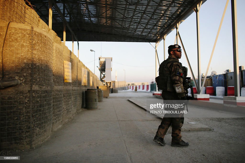 A French soldier stands guard at a check point at Warehouse base in Kabul on December 31, 2012. All French combat troops have now been withdrawn from Afghanistan and only training and logistics personnel remain there.
