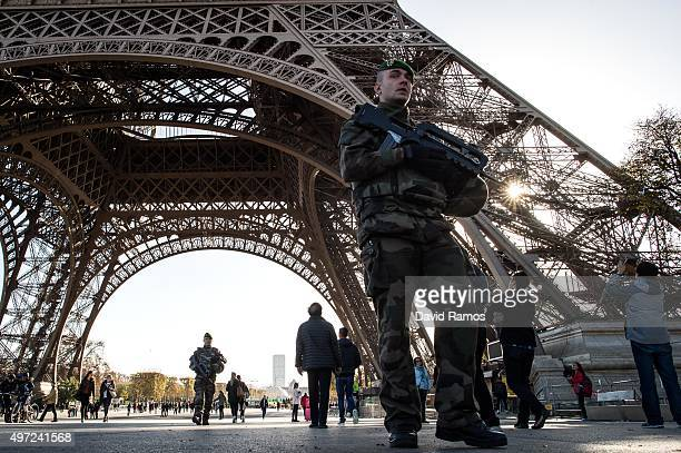 French soldier stands guard at Eiffel Tower on November 15 2015 in Paris France As France observes three days of national mourning members of the...