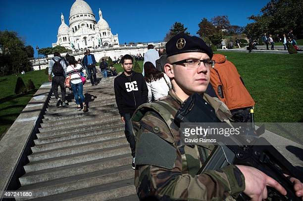 French soldier stands guard at the 'SacreCoeur' cathedral on November 15 2015 in Paris France As France observes three days of national mourning...