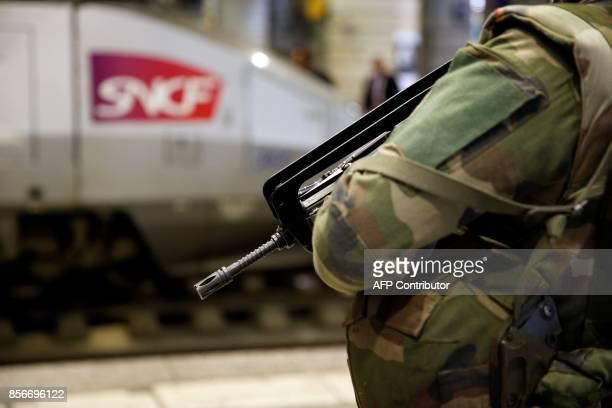 A French soldier stands guard at the train station Gare Montparnasse in Paris on October 2 2017 as part of the Sentinelle military force security...