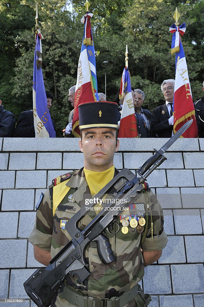 A French soldier stands guard during a ceremony in Tulle, central France, on June 9, 2013, to commemorate the Nazi massacre of Tulle in 1944.