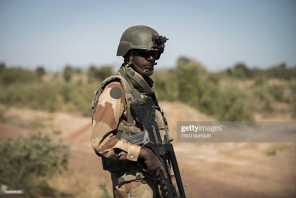 A French soldier stands guard near Markala, on January 18, 2013. France now has 1,800 troops on the ground in Mali, inching closer to the goal of 2,500 it plans to deploy in its African former colony, Defence Minister Jean-Yves Le Drian said today. That was 400 more than a day earlier, said the minister as he met with French special forces in the western port of Lorient. The troops have been sent to help the Malian army regain control of the north from Islamist groups.
