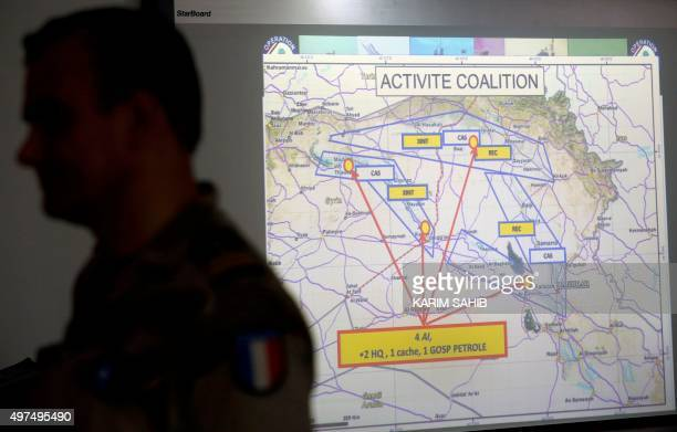A French soldier stands in a control room at a French military base at an undisclosed location in the Gulf on November 17 as he monitors operations...