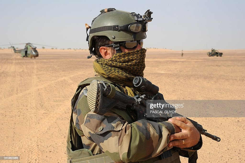 A French soldier stands in the desert near the city of Bourem, northern Mali, on February 17, 2013. A French-led military intervention launched on January 11 has driven the Islamist rebels in Mali from the towns they controlled, but concerns remain over stability amid suicide attacks and guerrilla fighting.
