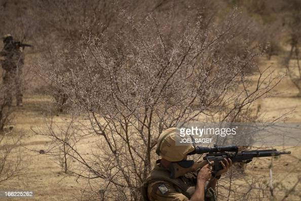 A French soldier takes part on April 10 105 kms north of the northeastern Malian city of Gao in day three of Operation Gustav a hunt for Islamist...