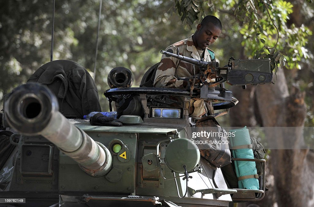 A French soldier works on a tank on January 20, 2013 in the city of Niono, about 350 kms (220 miles) northeast of the capital Bamako and 60 kms south of Diabaly, which was seized on January 14 by Islamists and then heavily bombed by French warplanes. A spokesman for the French military operation codenamed Serval said on January 20 that French forces were advancing towards Mali's Islamist-held north after taking up positions in the towns of Niono and Sevare. SANOGO