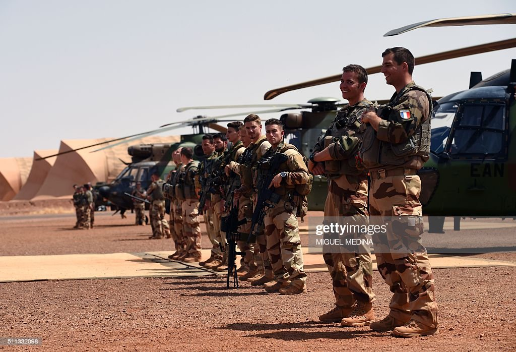 French soldiers and officers of Barkhane counterterrorism operation in Africa's Sahel region wait for the arrival of France Prime Minister and France...