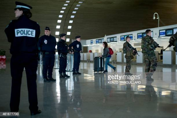 French soldiers and police patrol at the Charles de Gaulle airport on January 17 2015 in RoissyenFrance north of Paris as part the Vigipirate plan...