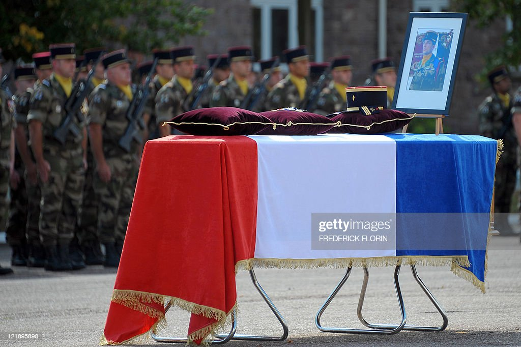 French soldiers attend the funeral ceremony of French lieutenant Camille Levrel, on August 19, 2011 in Colmar, eastern France. Levrel, a 36-year-old officer who had also served in Kosovo and Chad, was shot dead in the northeastern Afghanistan region of Kapisa on August 14, 2011. The lieutenant's death, which took place during a support mission for the national Afghan forces, brings to 74 the number of French soldiers killed in Afghanistan since 2001 AFP PHOTO /FREDERICK FLORIN