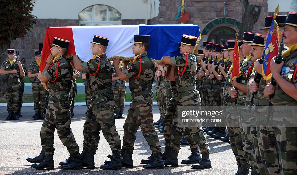 French soldiers carry the coffin of French lieutenant Camille Levrel, on August 19, 2011 in Colmar, eastern France, during his funeral ceremony. Levrel, a 36-year-old officer who had also served in Kosovo and Chad, was shot dead in the northeastern Afghanistan region of Kapisa on August 14, 2011. The lieutenant's death, which took place during a support mission for the national Afghan forces, brings to 74 the number of French soldiers killed in Afghanistan since 2001