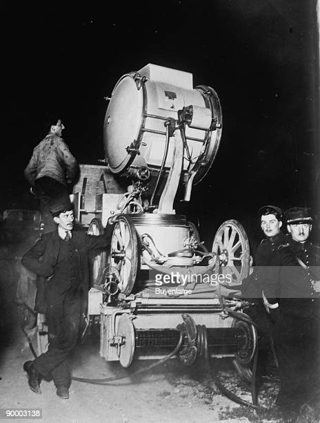French Soldiers employ Searchlights to Scan the Sky for German Zeppelins