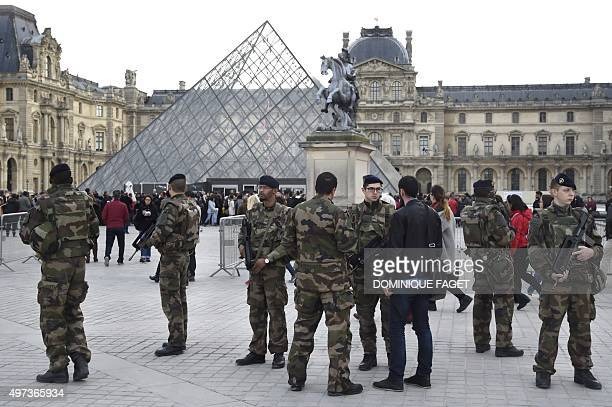 French soldiers enforcing the Vigipirate plan France's national security alert system patrol in front of the Louvre museum the day of its reopening...