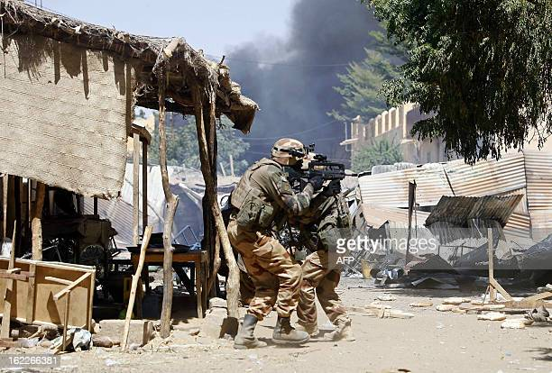 French soldiers fight while clashes erupted in the city of Gao on February 21 2013 and an apparent car bomb struck near a camp housing French troops...
