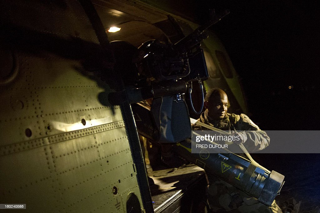 French soldiers flying back from the city of Timbuktu, arrive at the French army base camp on January 28, 2013 in Sevare, located 630 kilometers north-east of Bamako. French-led forces Monday seized Mali's fabled desert city of Timbuktu in a lightning advance north as fleeing Islamists torched a building housing priceless ancient manuscripts.