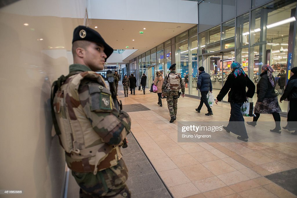 French soldiers from 7th BCA, guarantee security of shopping malls on January 16, 2015 in Lyon, France. France announced on January 12 an unprecedented deployment of soldiers and policemen to boost security, after seventeen people were killed in terrorist attacks that began with an assault on the satirical Charlie Hebdo magazine last Wednesday and ended in a siege at a Jewish supermarket two days later.