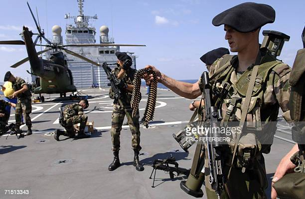 French soldiers from 7th BCA receive ammunition to secure the unloading of relief goods aboard the French warship Siroco for the United Nations...