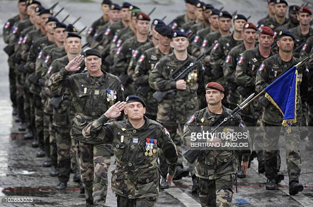 French soldiers from Detachment Epidote which provides training to the Afghan Army take part in the annual Bastille Day military parade in Paris July...