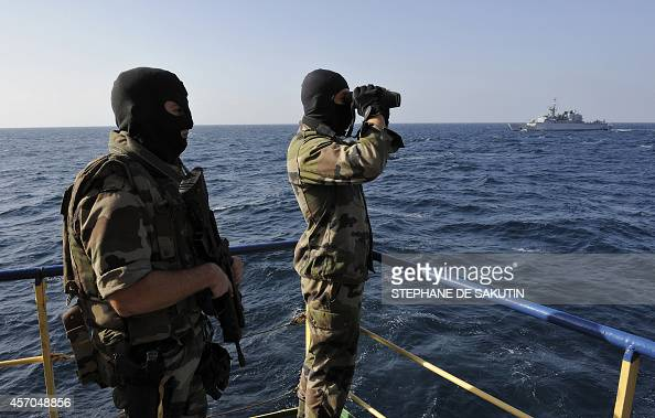 French soldiers from EPE patrol on January 10 2009 aboard the French Frigate 'le Floreal' in the Gulf of Aden as they escort a danish commercial ship...