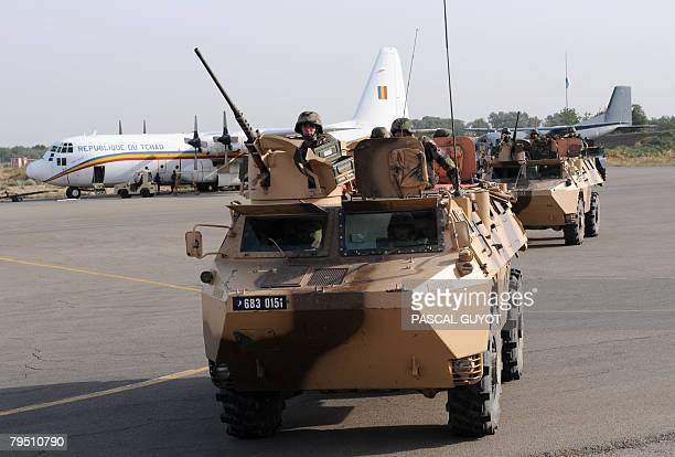 French soldiers from the 21st Marine Infantry Regiment based in Frejus patrol in armoured vehicles on the tarmac at N'Djamena airport on February 4...