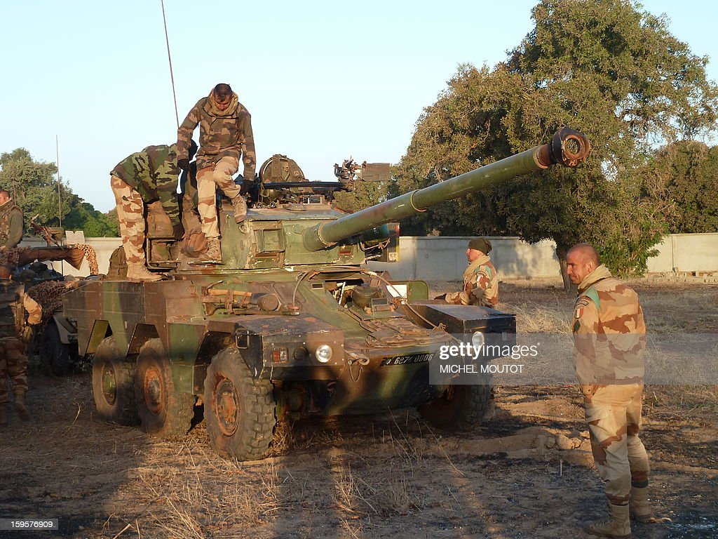 French soldiers from the 21st Rima (French Navy Infantry Regiment) stand on a Panhard ERC 90 Sagaie, with 90 mm gun, a French six-wheeled armoured all terrain reconnaissance vehicle, near the town of Markala to secure a strategic bridge on the Niger river on January 16, 2013 after leaving the capital Bamako the day before. After days of airstrikes on Islamist positions in the northern territory the rebels seized in April, French and Malian troops battled the insurgents in the small town of Diabaly, some 400 kilometres (250 miles) north of Bamako.