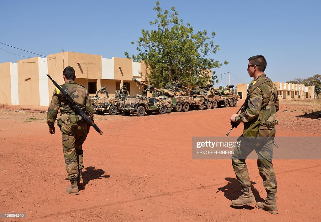 French soldiers from the 21st Rima walk past Sagaie tanks near the Malian army 101 airbase, where French troops are stationed, on January 18, 2013, near Bamako. France now has 1,800 troops on the ground in Mali, inching closer to the goal of 2,500 it plans to deploy in its African former colony, Defence Minister Jean-Yves Le Drian said today. That was 400 more than a day earlier, said the minister as he met with French special forces in the western port of Lorient. The troops have been sent to help the Malian army regain control of the north from Islamist groups.