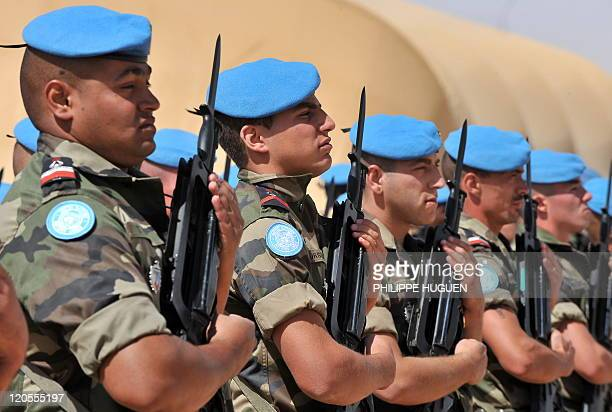 French Soldiers from the 517éme Régiment du Train de Chateauroux on March 15 2009 receive their blue UN peacekeeping berets in the eastern Chadian...