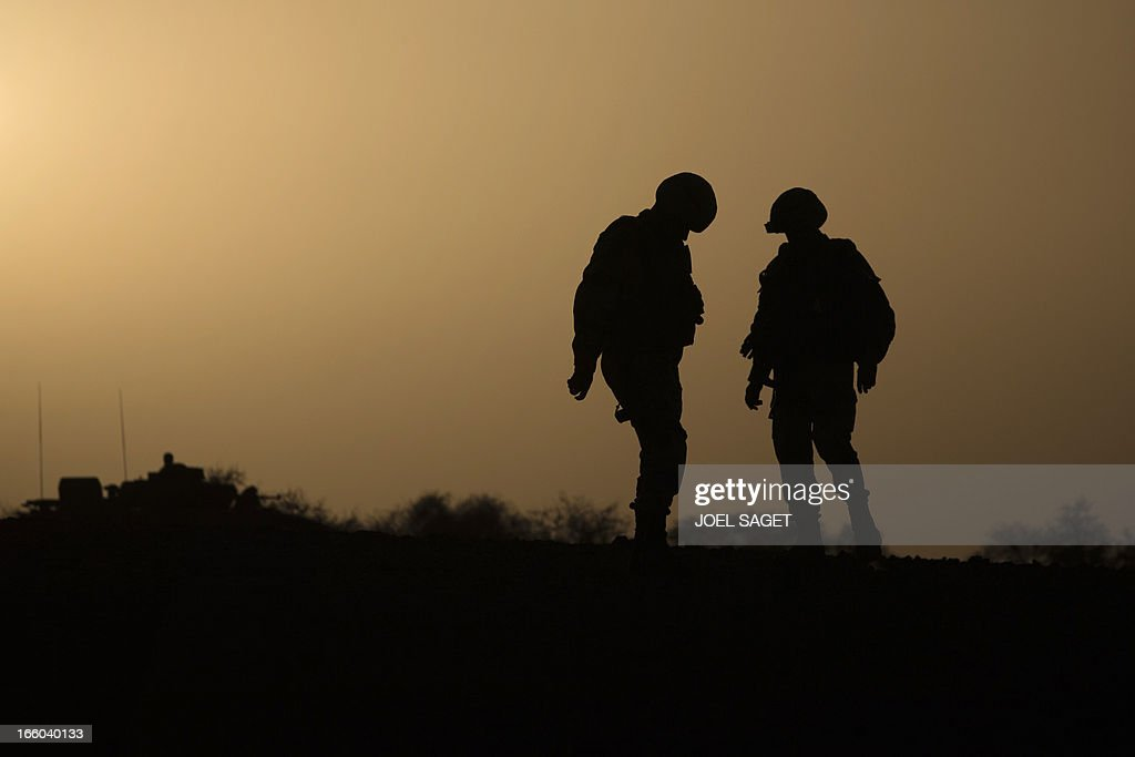 French soldiers from the 92nd Infantery Regiment stand in the desert on April 7, 2013 some 105 kilometers North of Gao. A French force of 1,000 soldiers has begun a sweep of a river valley thought to be a logistics base for armed Islamists near the Malian city of Gao, an AFP journalist accompanying the mission said. Operation Gustav, one of France's largest actions since its intervention against insurgents in January, will involve dozens of tanks, helicopters, drones and airplanes, said General Bernard Barrera, commander of the French land forces in Mali. AFP PHOTO / JOEL SAGET