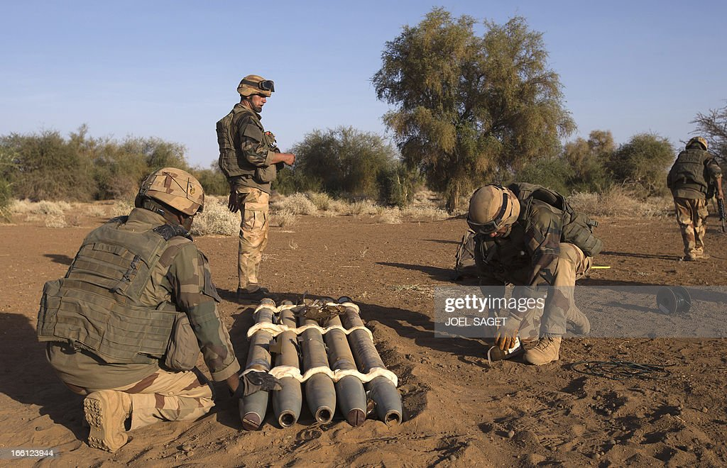 French soldiers from the 92nd Regiment Infantery prepare to destroy Russian rockets allegedly belonging to Mujao forces on April 8, 2013 during a military operation some 105 kilometers North of Gao. A French force of 1,000 soldiers in a major offensive has swept a valley thought to be a logistics base for Al-Qaeda-linked Islamists near the Malian city of Gao. Operation Gustav, one of France's largest actions since its intervention against insurgents in January, will involve dozens of tanks, helicopters, drones and airplanes, said General Bernard Barrera, commander of the French land forces in Mali. France is to start withdrawing its 4,000 troops from Mali at the end of April, and plans to leave a 'support force' of 1,000 soldiers after elections promised for July. AFP PHOTO / JOEL SAGET