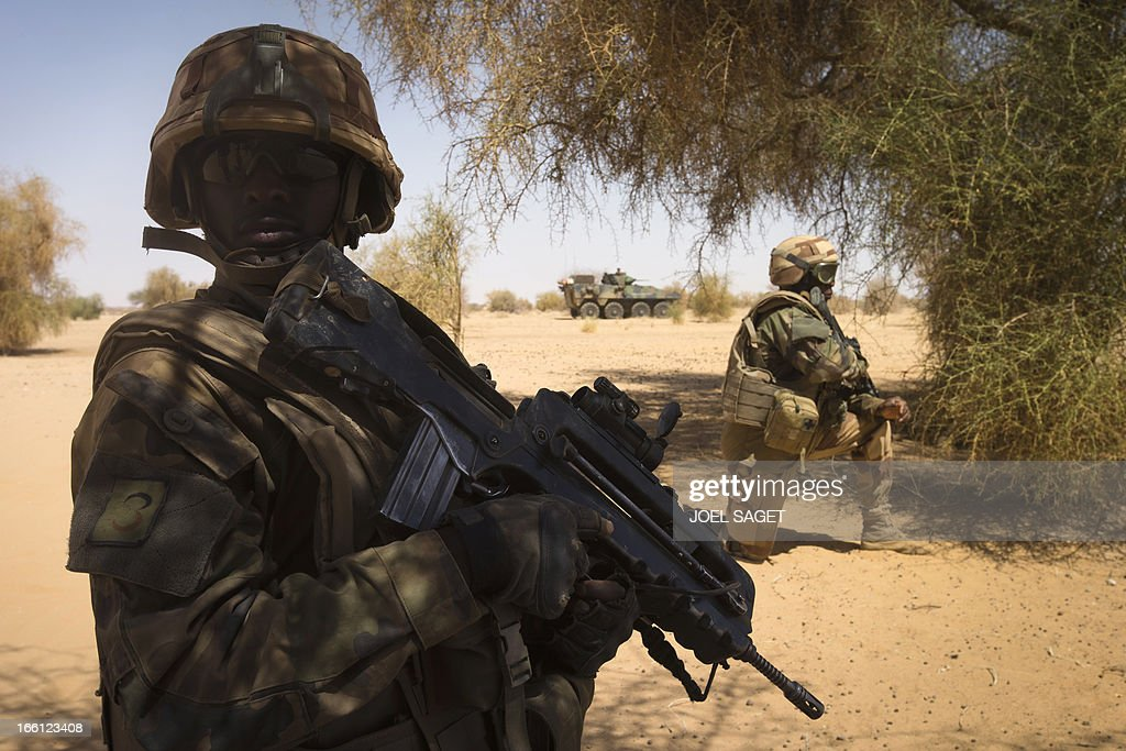 French soldiers from the 92nd Regiment Infantery take part in a military operation on April 8, 2013 some 105 kilometers North of Gao. A French force of 1,000 soldiers in a major offensive has swept a valley thought to be a logistics base for Al-Qaeda-linked Islamists near the Malian city of Gao. Operation Gustav, one of France's largest actions since its intervention against insurgents in January, will involve dozens of tanks, helicopters, drones and airplanes, said General Bernard Barrera, commander of the French land forces in Mali. France is to start withdrawing its 4,000 troops from Mali at the end of April, and plans to leave a 'support force' of 1,000 soldiers after elections promised for July.