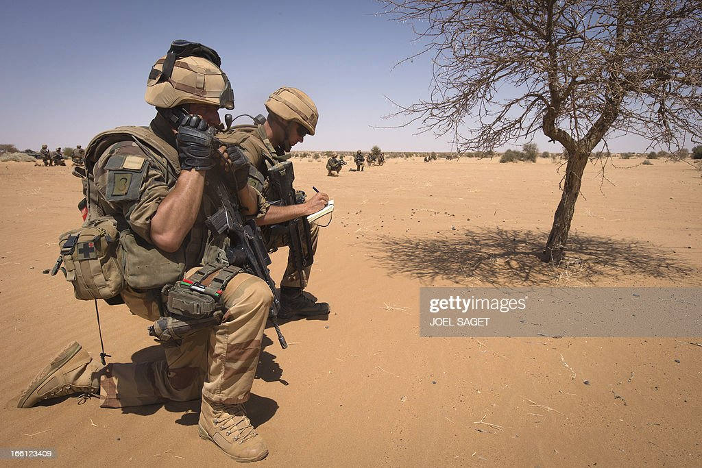 French soldiers from the 92nd Regiment Infantery take part in a military operation on April 8, 2013 some 105 kilometers North of Gao. A French force of 1,000 soldiers in a major offensive has swept a valley thought to be a logistics base for Al-Qaeda-linked Islamists near the Malian city of Gao. Operation Gustav, one of France's largest actions since its intervention against insurgents in January, will involve dozens of tanks, helicopters, drones and airplanes, said General Bernard Barrera, commander of the French land forces in Mali. France is to start withdrawing its 4,000 troops from Mali at the end of April, and plans to leave a 'support force' of 1,000 soldiers after elections promised for July. AFP PHOTO / JOEL SAGET