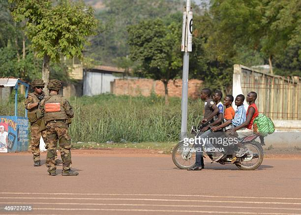 French soldiers from the Sangaris operation stand guard as a motorcylce with five men stops by in Bangui on December 29 2013 The United Nations said...