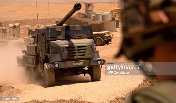 French soldiers from the Wagram Task Force drive a unit of CAESAR a French selfpropelled 155 mm howitzer north of Mosul on July 13 as the French army...