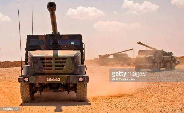 French soldiers from the Wagram Task Force drive units of CAESAR a French selfpropelled 155 mm howitzer north of Mosul on July 13 as the French army...