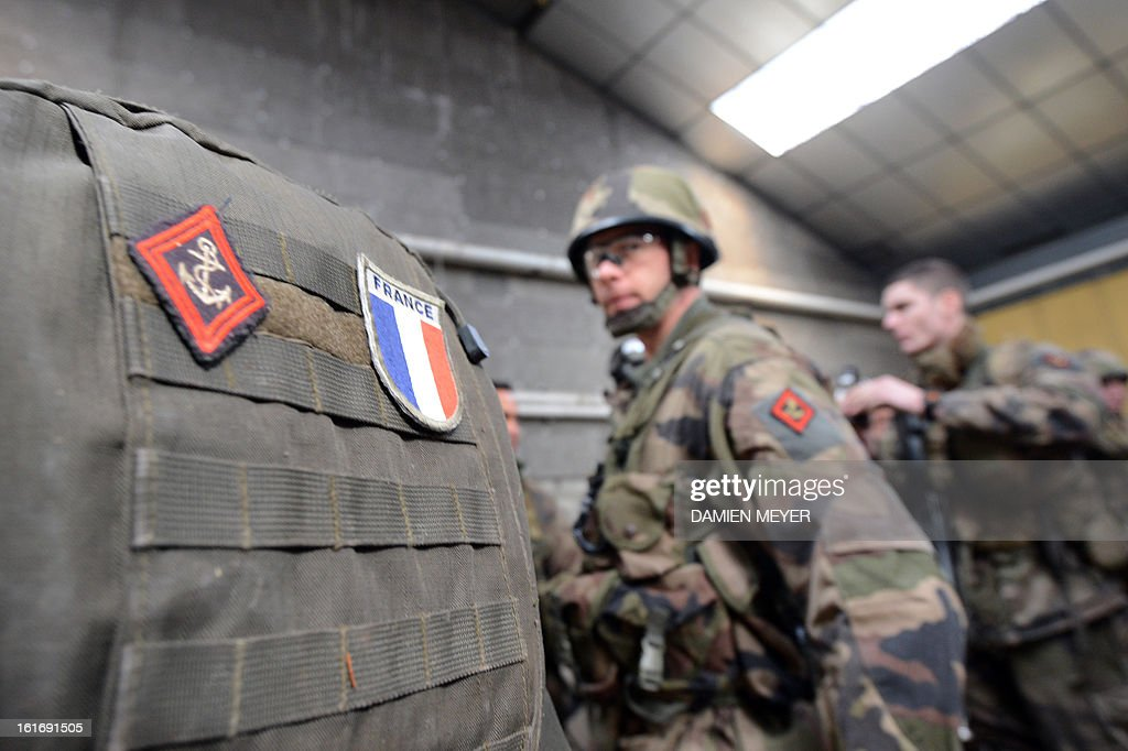 French soldiers from third RIMA (Marine Infantry Regiment) take part in a drill, on February 14, 2013 in Meucon, western France.