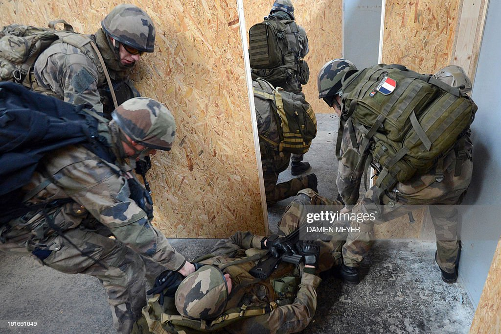 French soldiers from third RIMA (Marine Infantry Regiment) take part in a drill , on February 14, 2013 in Meucon western France.