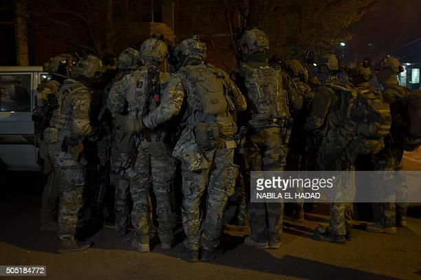 TOPSHOT French soldiers gather in the surrounding of the hotel Splendide and the café Cappuccino during the attack on January 15 2016 Sixtythree...