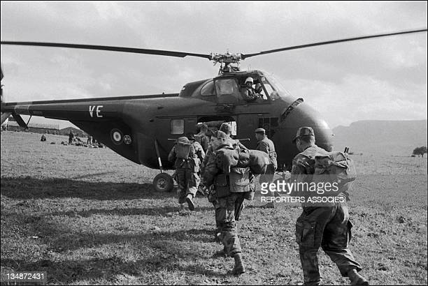 French soldiers getting back to the helicopter during 'Operation Bigeard' in March 1956 when an armed outbreak in SoukAhras South of Constantine...