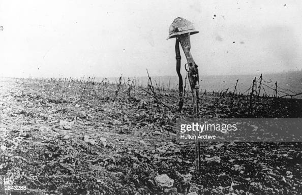 A French soldier's grave marked by his rifle and helmet on the battlefield of Verdun