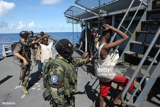 French soldiers guard suspected Somali pirates on board the French warship 'Le Nivose' after their capture on May 3 as part of EU's Atalante...