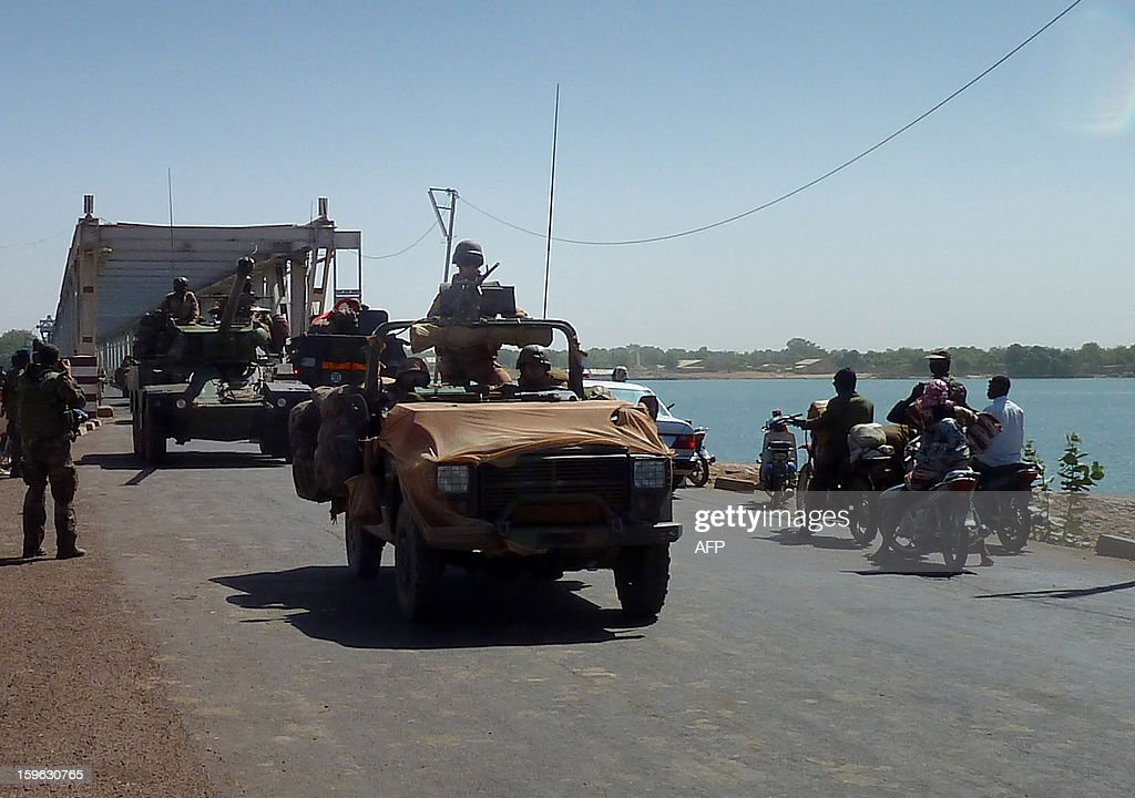 French soldiers in a jeep and a Sagaie tank from the 21st Rima (French Navy Infantry Regiment) arrive to secure the strategic bridge on the Niger river on January 16, 2013 after leaving the capital Bamako the day beforeon the Niger river on January 16, 2013 near the town of Markala. French soldiers from the 21st Rima (French Navy Infantry Regiment) arrived in the town to secure the strategic bridge on the Niger river on January 16, 2013 after leaving the capital Bamako the day before. After days of airstrikes on Islamist positions in the northern territory the rebels seized in April, French and Malian troops battled the insurgents in the small town of Diabaly, some 400 kilometres (250 miles) north of Bamako.